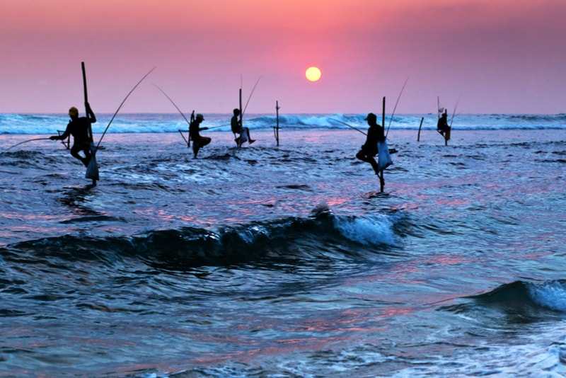 Traditional Fishermen Silhouettes - Places to Visit in Sri Lanka
