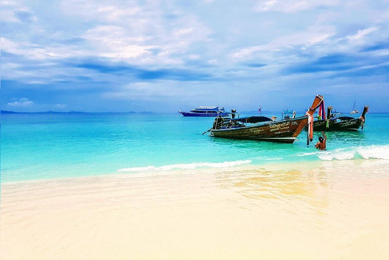 Boats on seashore in Phi Phi