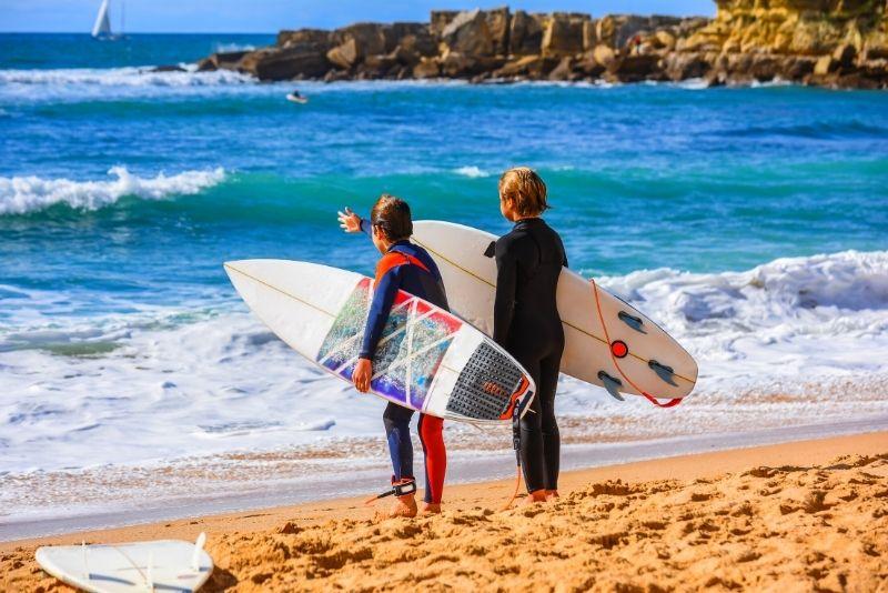 surfing in Carcavelos Beach, Lisbon